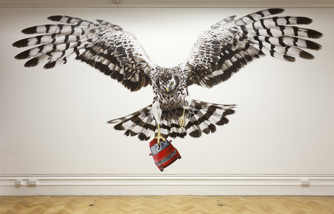 Photo of a mural depicting a hen harrier crushing a range rover at Jeremy Deller's English Magic exhibition at Bristol Museum & Art Gallery