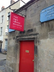Image of a Red front door and red sign