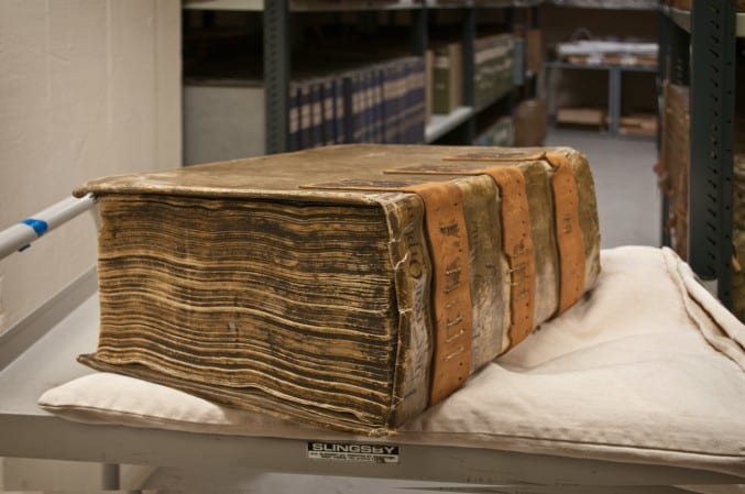 Photograph of an old book in the Bristol Archives strongroom