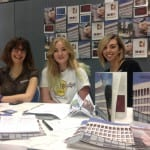 Photo of 3 women at a stand at the UWE volunteer fair