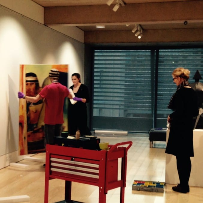 Photo of curators installing An Open Window exhibition at The Wilson, Cheltenham