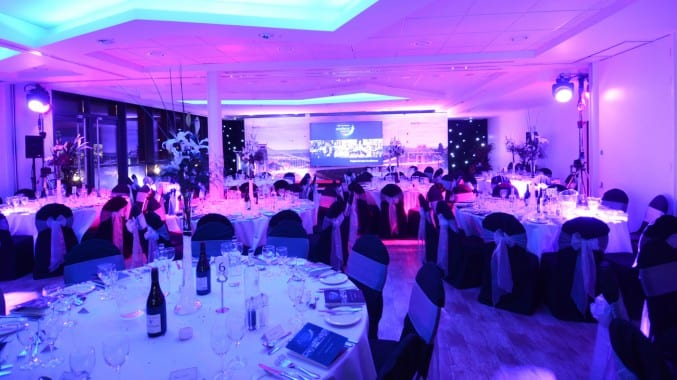 Photo of the M Shed Event Suite with tables set up for an evening reception