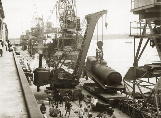 Unloading a locomotive boiler at Kilindini harbour, Kenya, c1926