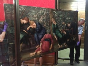 Photo of people carrying burne-jones' garden court painting