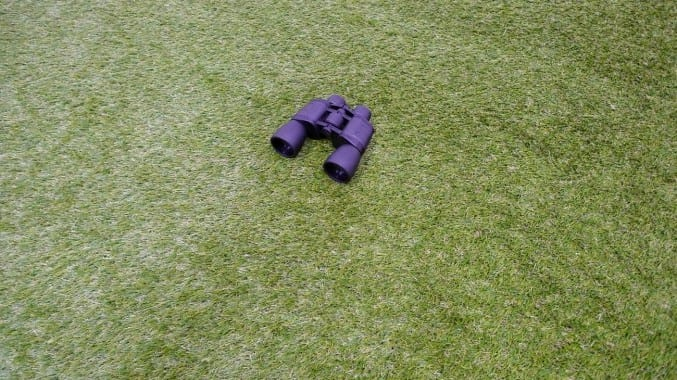 Photo of a pair of binoculars on grass