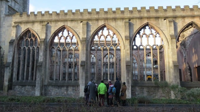 Walkers outside the remains of Temple Church, Redcliffe, bombed during the Bristol Blitz.