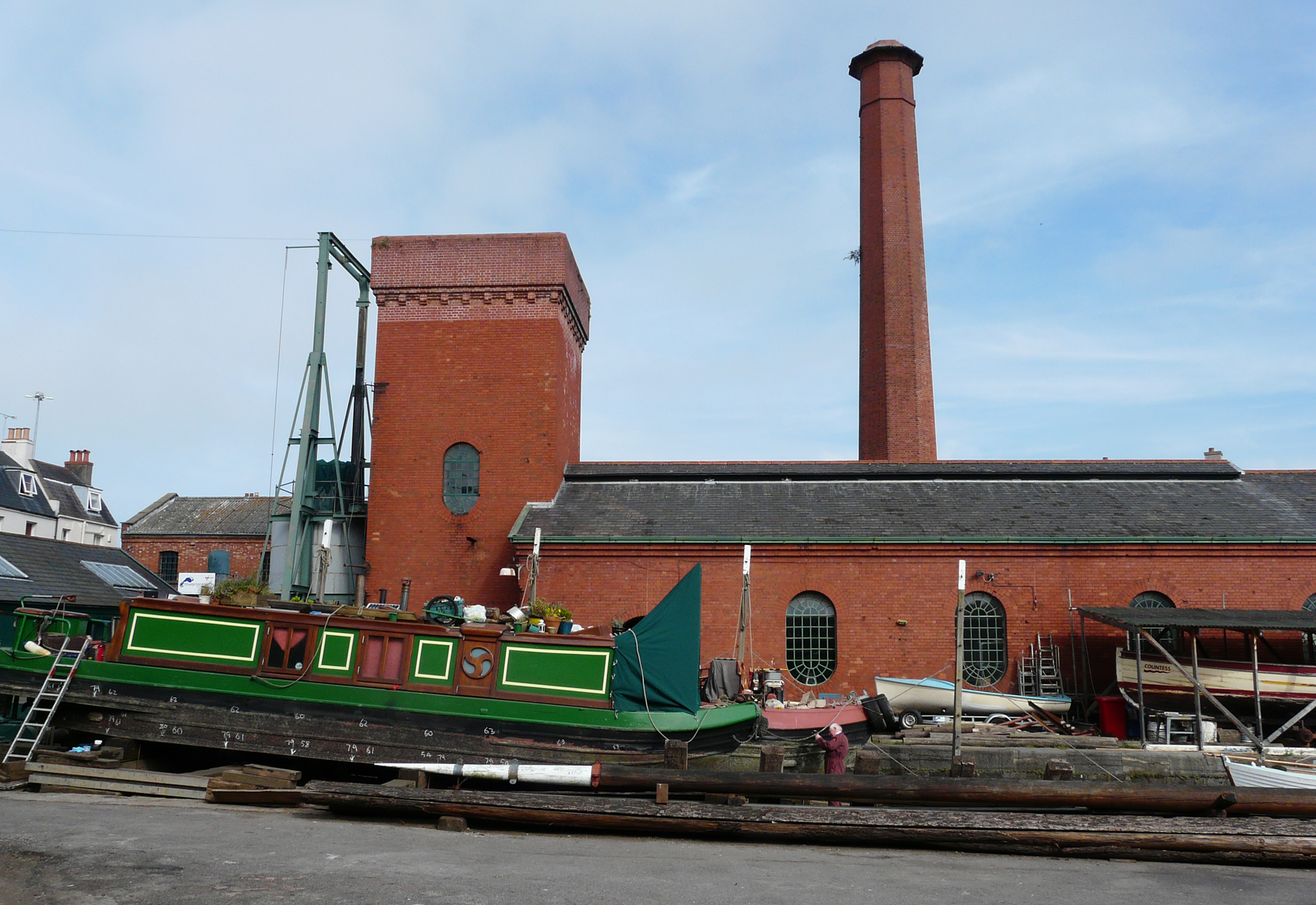 The hydraulic accumulator and engine house at Underfall Yard, with a narrow boat on the patent slip, 2014.