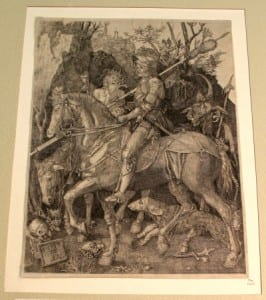 Black and white engraving of a man riding a horse with a personification of death next to him