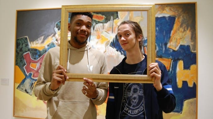 Two young men in the modern and contemporary art gallery