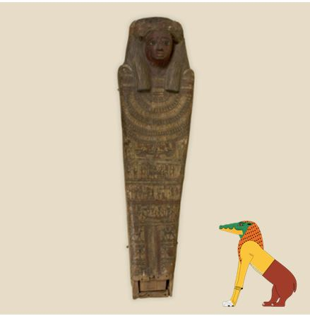 The lid of the Egyptian coffin belonging to Paty-hewty, accompanied by a cartoon version of an Ammit.