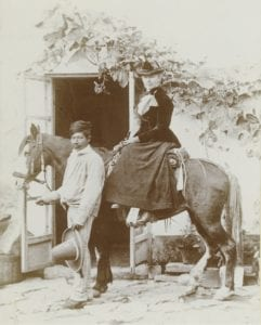 Adela Breton pictured sitting on a horse next to her guide Pablo Solorio