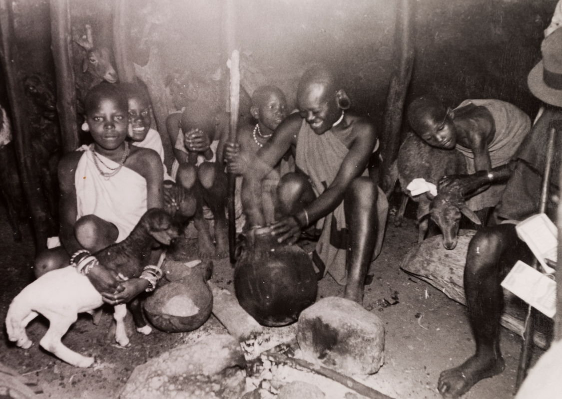 Image of a group from the Kikuyu tribe cooking a meal