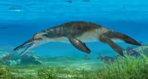 A pliosaur swimming in the sea surrounded by Jurassic marine life