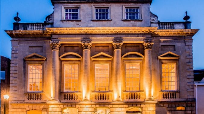 The exterior of Bristol Old Vic lit up at dusk