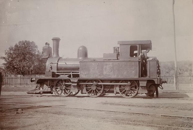 Photogrpah showing a British-manufactured steam locomotive at a siding from the Jamaica Railway