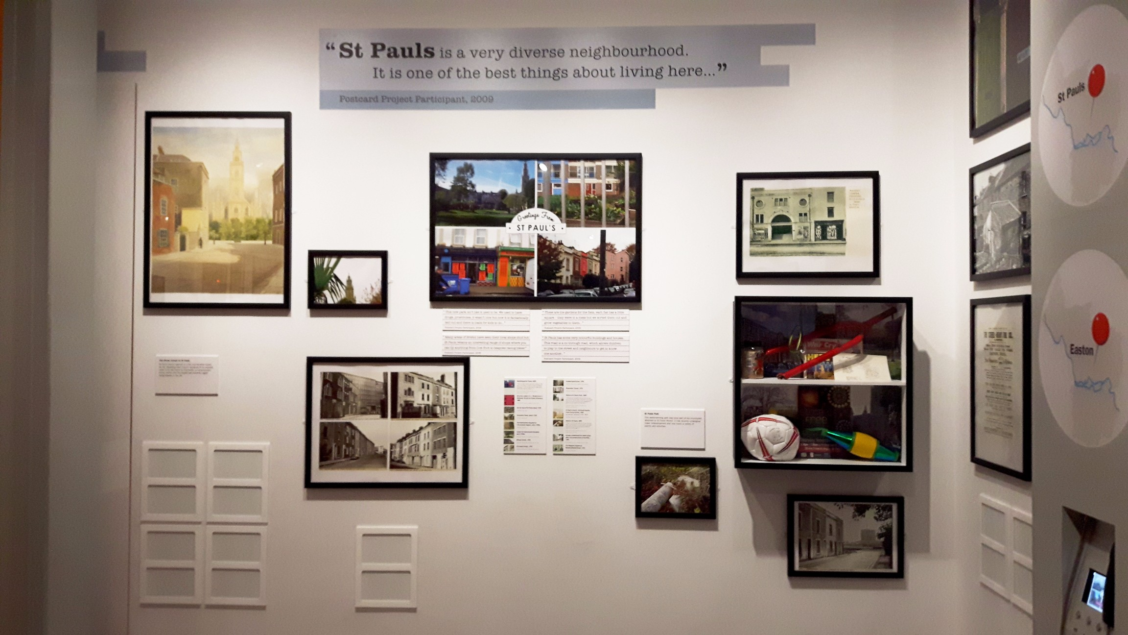Photo of St. Paul's display in M Shed's Place Gallery, showing images and text about community life.