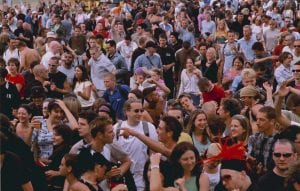 Hundreds of people in a crowd at Ashton Court in 1990
