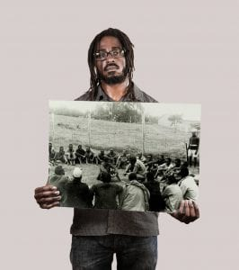 man holding photograph