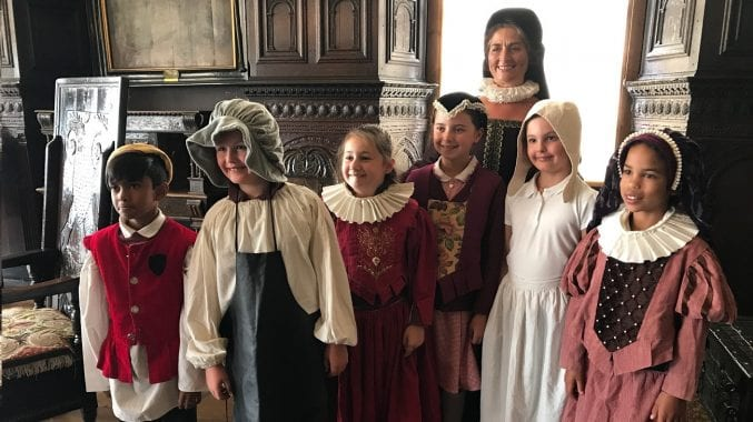 Six children and their teacher dressed in Tudor costume