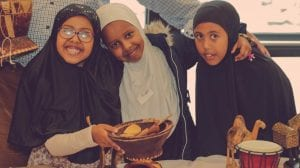 Group of smiling girls at last years Somali Family Fun Day.