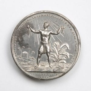 Transatlantic Slave Trade: commemerative coin showing breaking the chains