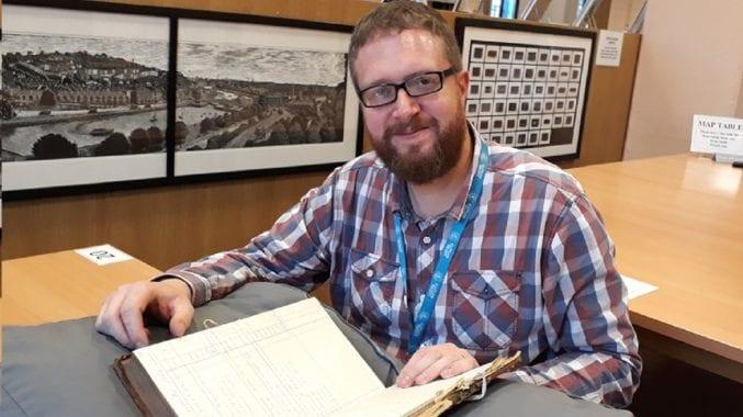 Dan Jones in the searchroom at Bristol Archives