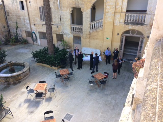 Symposium delegates in the courtyard during lunch