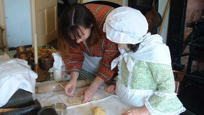 photo of a woman and child cooking during a workshop at the georgian house museum