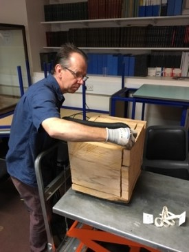 David, the Preventative Conservator cleaning Nash's Cracking Box (K5623) with the 'Museum Vac'.
