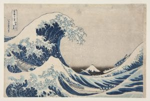 A Japanese print featuring a wave cresting