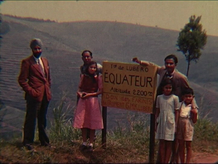 Image of three men and three children stood by a sign marking the equator (British Empire and Commonwealth Collection)