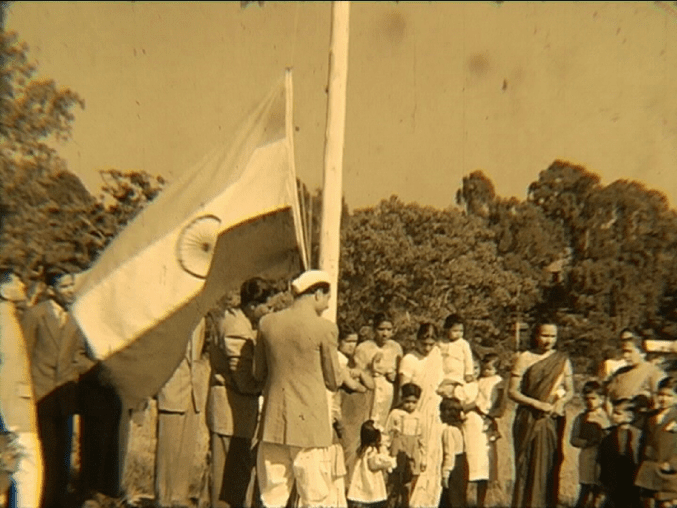 Image showing people gathering around the Indian flag
