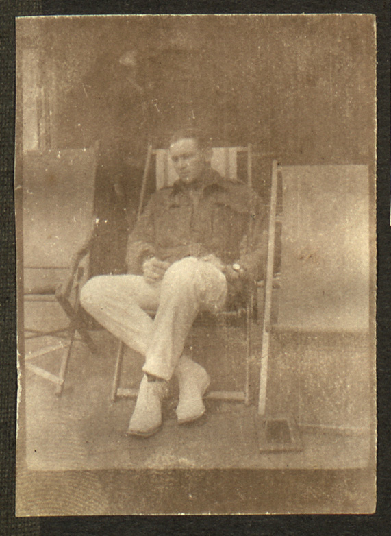 An old photograph of one of Margaret's wounded Australian soldier friends, as mentioned in her diary. He is sat with his legs crossed on a stripey deck chair