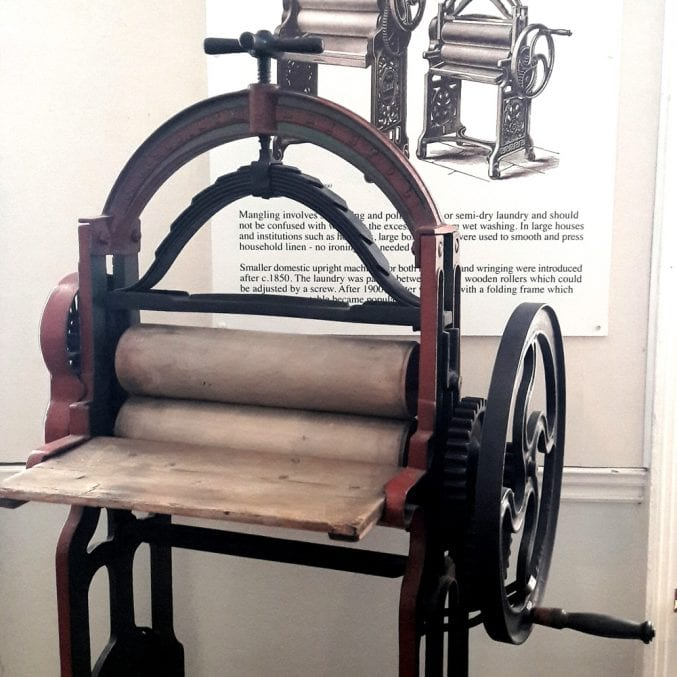 Photo of a wringer on display at blaise castle house museum
