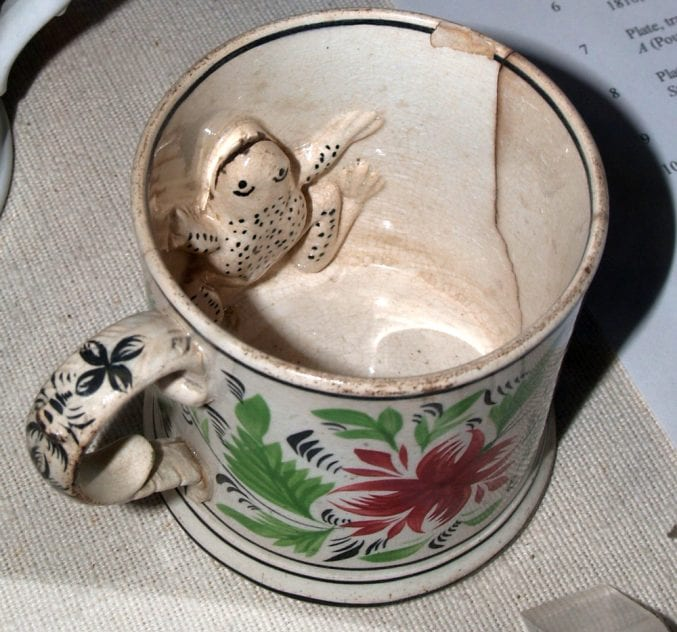 Photo of a mug with a frog on the inside