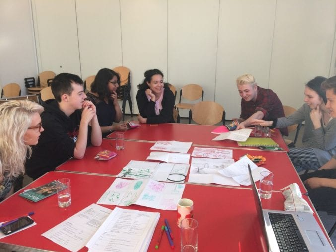 The Bristol Museums Youth Panel sat around a table