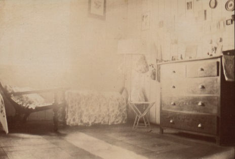 An archive photo of Margaret's room in the PO Bungalow, with the home made covers for boxes clearly visible