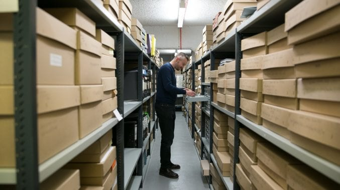 Phil Owen working behind the scenes at Bristol Archives. (Photograph courtesy of Lisa Whiting)