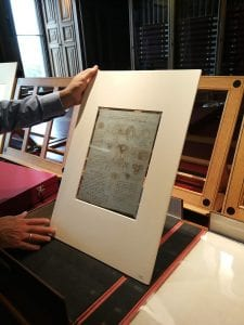 Martin Clayton holding up one of Leonardo da Vinci's drawings