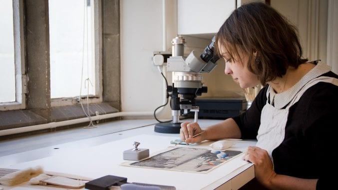Paper conservator Ellie Hasler working on one of the Japanese prints © Eve Andreski