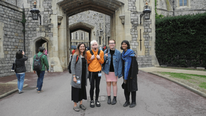 Anika, Marcin and Maisie stood outside Windsor Castle with Claire Simmons - the project coordinator