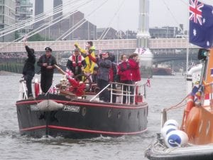 The Pyronaut. Boat full of people sails on the Thames.