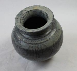 Black ceramic pot by Ladi Kwali