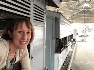 Nicky Sugar leaning out of an original Uganda Railways train