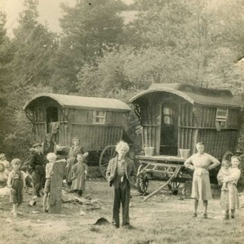 Black and white photograph of traveller families and 2 Romany 'Gypsy' caravans/ 'vardos'.
