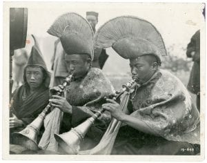 Buddhist monks blowing horns in Bhutan, 1930s (ref. 2018/007/1/20)
