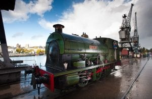 A green steam train called Henbury on the harbourside outside M Shed