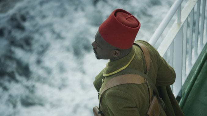 A Black soldier looking out over the ocean