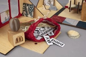 Some of the contents of Artbox including tiles featuring words including 'sky' 'paint' and 'marbled'