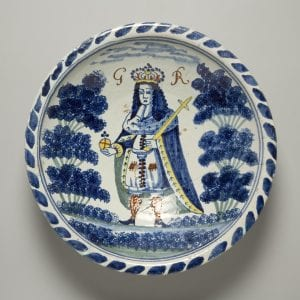 A Delftware dish featuring George I